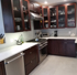 Picture of Custom Kitchen Cabinets with top Glass doors